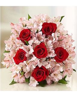 Red Roses in a Pink Bunch