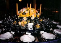 formal flower arrangement with candles